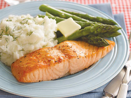 salmon, mashed potatoes and vegetables