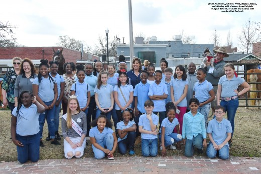 Bruce Anderson, Julianne Neal, Roslyn Moore, and Marley with students from Fairfield Magnet School for Math and Science with teacher Kimi Daly (c).