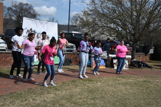 Students entertain the audience with their singing and dancing.