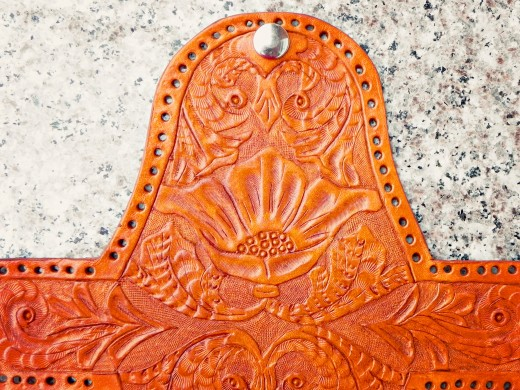 The hand carved leather coin purse after the dyeing stage.