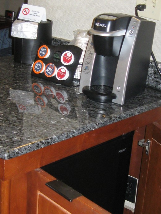 Coffee maker and selections on top of refrigerator cabinet