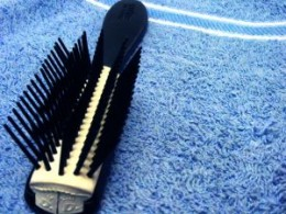 Wide firm platic bristles... small bristles just get caught up in curls.