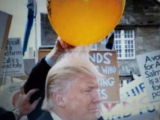 President Trump's hair stands on end.due to Static Electricity