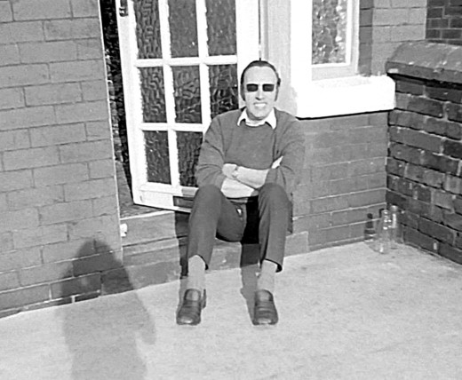 Dad in the 1970s, soaking up the sun on our front doorstep after work one summers evening.