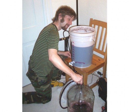 Racking red wine. i.e. siphoning the liquid from primary fermentation vessel to secondary fermentation vessel (carboy) removes most of the lees (solids) from the liquid.