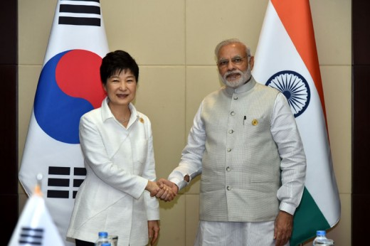 the Prime Minister of India, Shri Narendra Modi shaking hands with the President of South Korea, Ms. Park Geun-hye