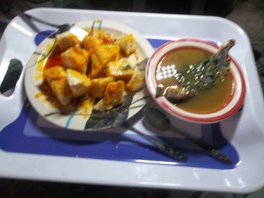 Cooked yam served with dried tilapia in basil soup
