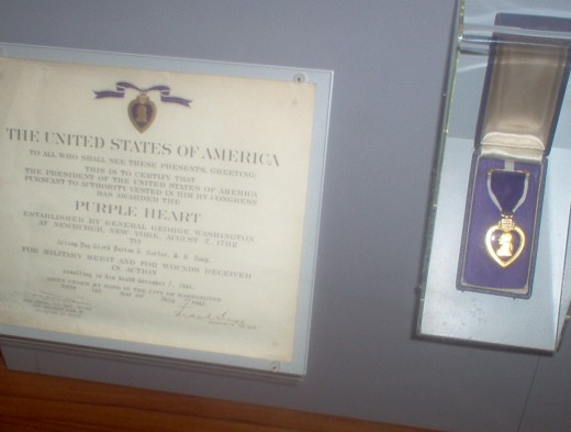 A fallen soldiers purple heart in museum.
