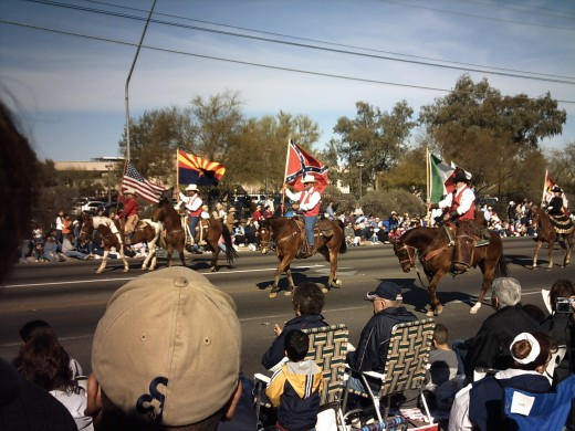 The Five Flags Over Tucson.  (Left to Right) American Flag, Arizona State Flag, Confederate Flag (we temporarily aligned with the Confederacy during the Civil War), Mexican Flag and Flag of Spanish Monarchs (far right in back)
