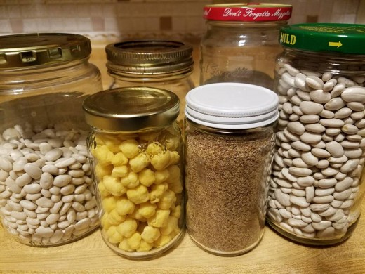 Reusing empty jam jars, pickle jars, and olive jars.