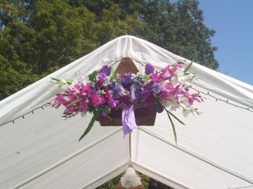 Simple flower arrangement that was made to decorate the entrance of the tent we rented.