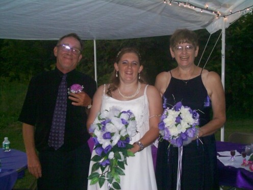 This is a photo of my dad, me and my mom. You can see the boutonniere that my dad is holding, my bouquet, and the bouquet that my mom was carrying--which is similar to the others that were made.