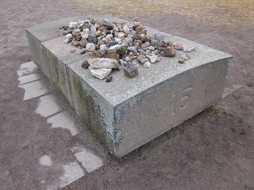 It is a Jewish tradition to place a rock on the graves of loved ones.  The rock symbolizes love and memory.
