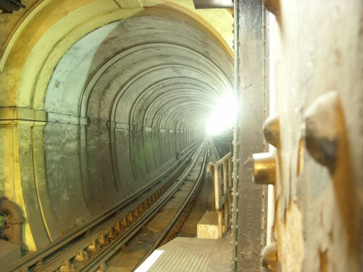 Thames Tunnel [ This happens to be the FIRST underwater TUNNEL that is credited to three MEN. ]