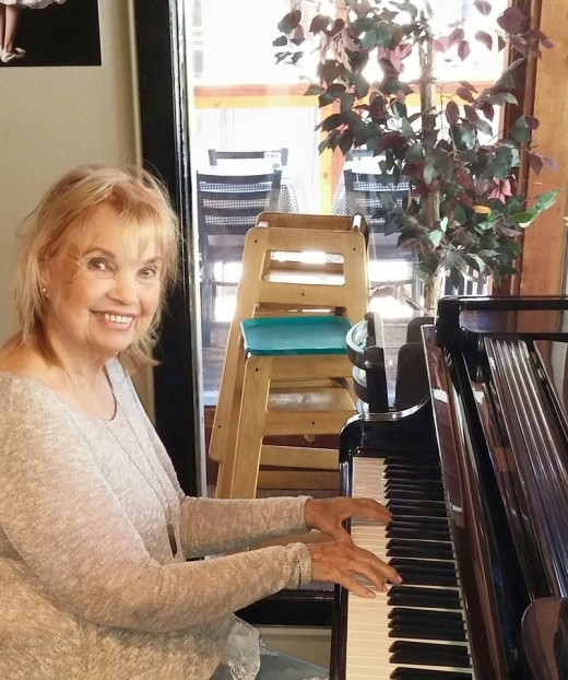 Author sharing  her love of piano with visitors from around the world at Idyllwild's popular restaurant.