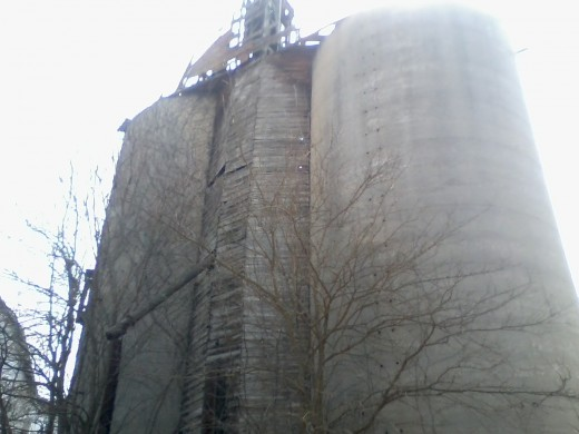 Here's a retired grain elevator alongside a bicycle trail that was once a railroad track. Note the chute in the foreground which was once used for loading rail cars with grain.