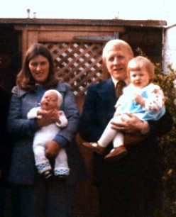 My husband and I with our two children who were born just one year apart. We were taller and thinner than we look in this photo scanning seems to have squashed us up a little.
