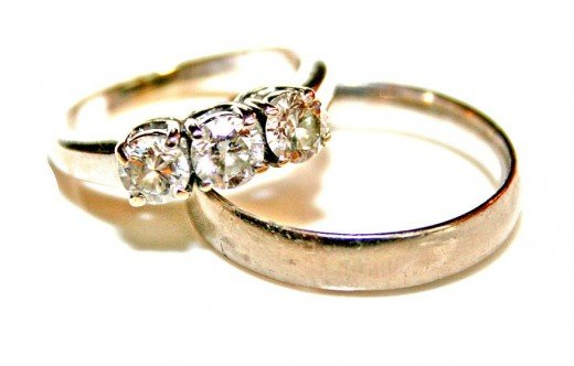 The karat value of your gold wedding band and engagement ring determine their color, durability and purchase price.
