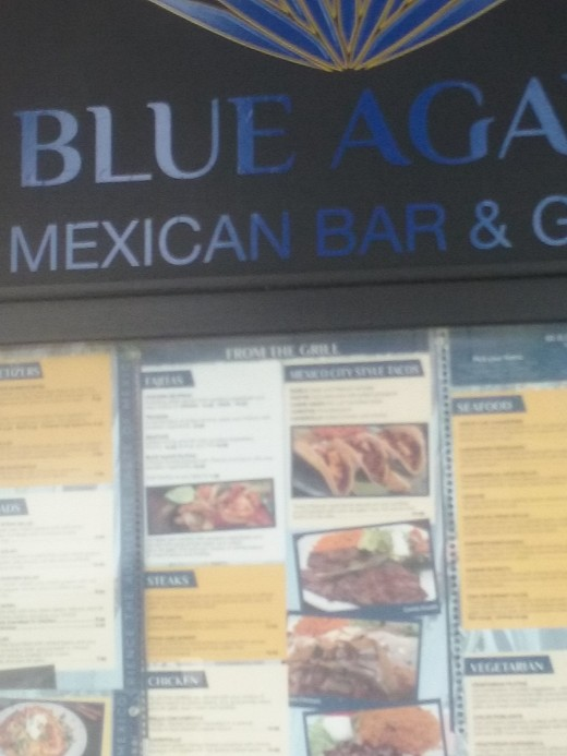 A restaurant food menu posted outside of Blue Agave Mexican Restaurant