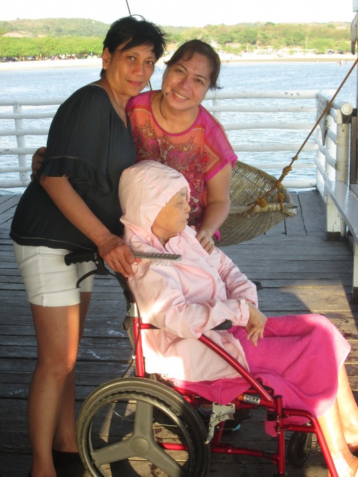 Lola and two of her daughters enjoy the ocean air in a cabin at Stilts