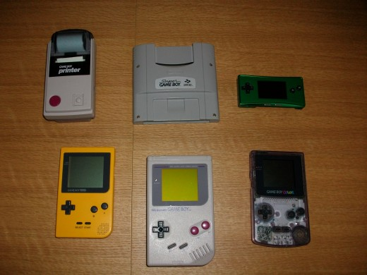 From top left to bottom-right:  Gameboy printer, Super Gameboy, Gameboy Micro, Gameboy Pocket Yellow, Gameboy Original, Gameboy Color.