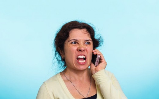 Woman is annoyed by a robocall, and it is probably not the first one she received on that day.