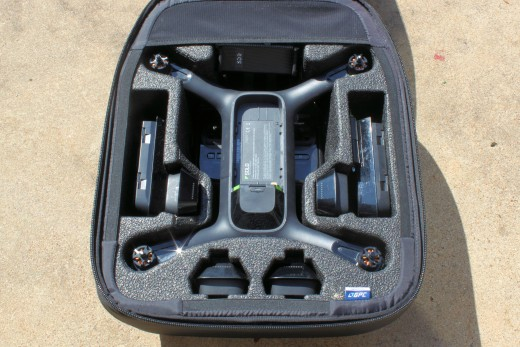 An example drone fishing package including a drone, controller, spare propellers, spare batteries, spare downriggers (dropping device), and screw driver.  The entire package fits neatly into a backpack.