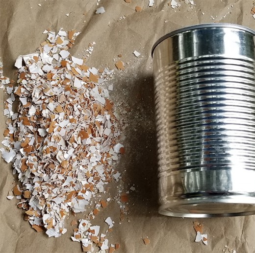 Option #2: Use a discarded can to roll over the eggshells to crush them.