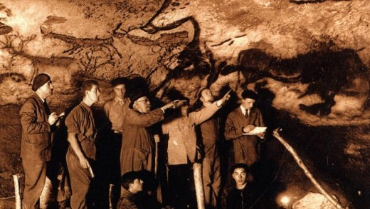 Marcel Ravidat showing people through the Lascaux cave in 1940.