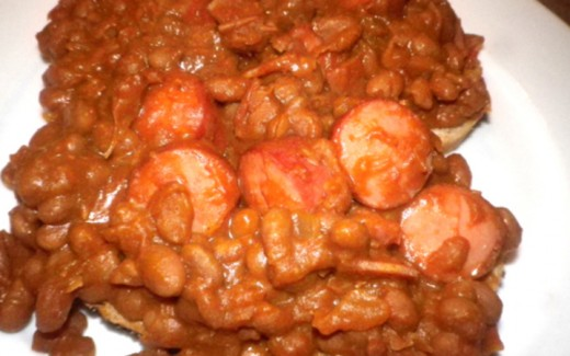 Hot dogs chopped up in pork and beans