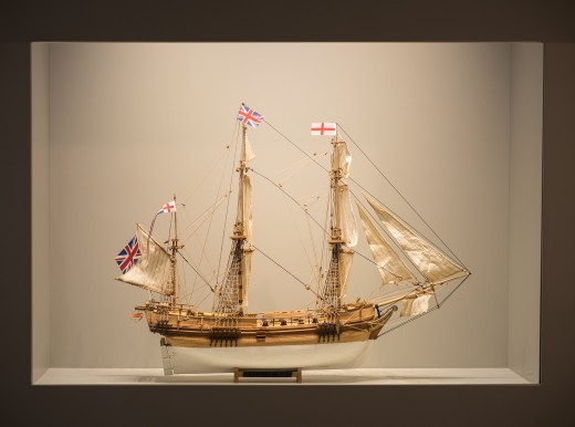 A handcrafted wooden replica of a British ship.