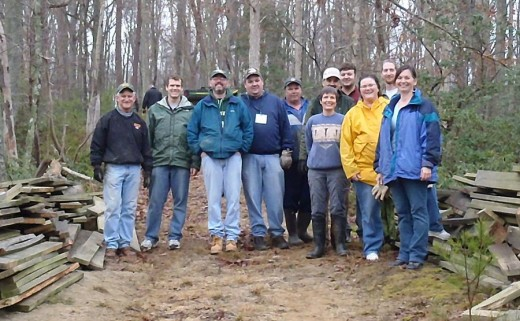 A group of volunteers learn new skills and make friends repairing paths on the Taskinas Creek Trail, Virginia, US