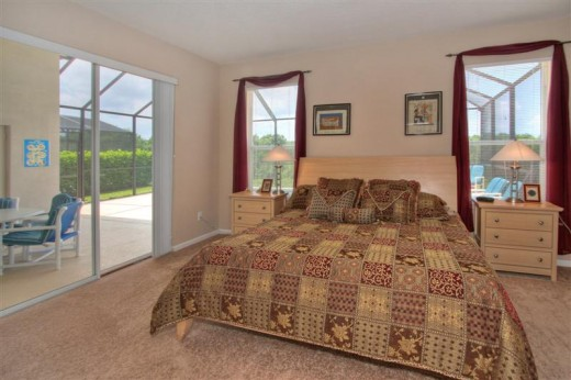 King Master Bedroom which opens onto the pool deck