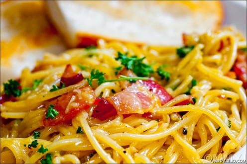 This is what a classic spaghetti carbonara looks like. You can see the vibrant colour that the egg yoke gives to the spaghetti.