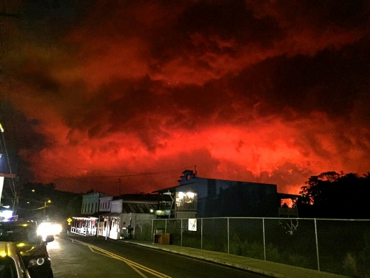 Lava flow - 3 miles away - lights up Pahoa village night sky. (Photo taken by author)