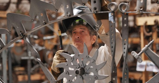 Bob Dylan at work, photo courtesy of Halcyon Gallery