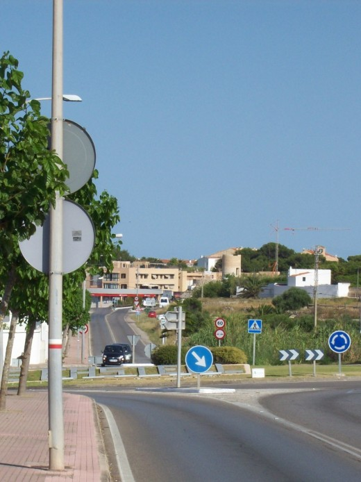 Walking in via the main road turn left at this roundabout and cut through the streets of Es Castell. This image is from a previous visit before the second iconic windmill was restored