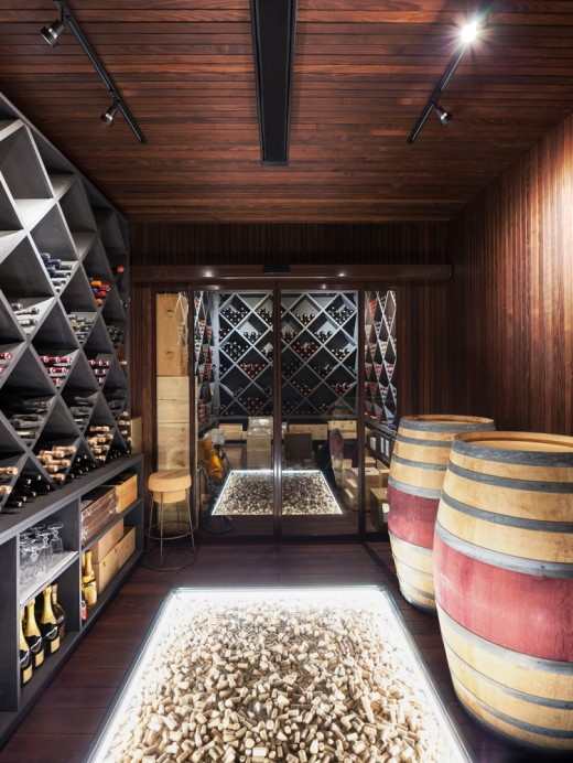 Modern cellar with a creative cork display on the floor accentuated with LED strip lights.