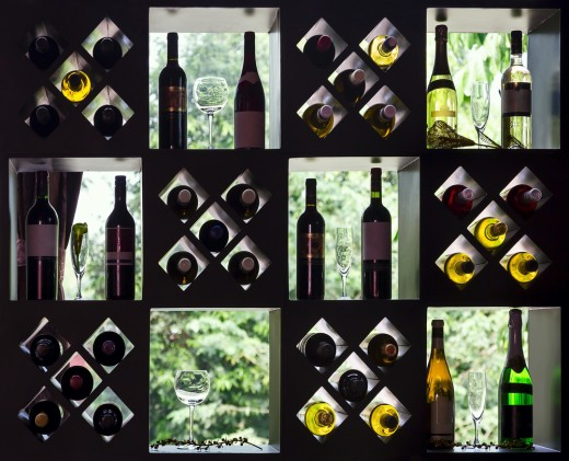 Chic wine rack placed over a glazed window. The natural light serves as back lighting.