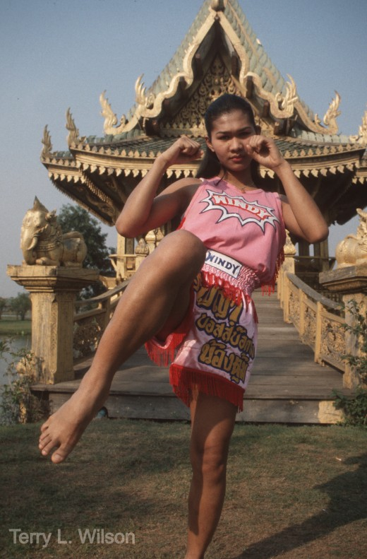Prinya Demonstrating a Muay Thai Knee Strike in Front of a Temple