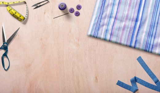 A fabric swatch, a pattern, and a pair of scissors starts the sewing project.