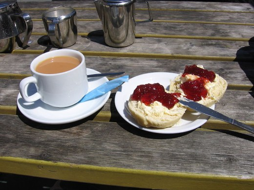 Scones, Cornsh cream and strawberry jam taste even better with a cup of strong English tea.