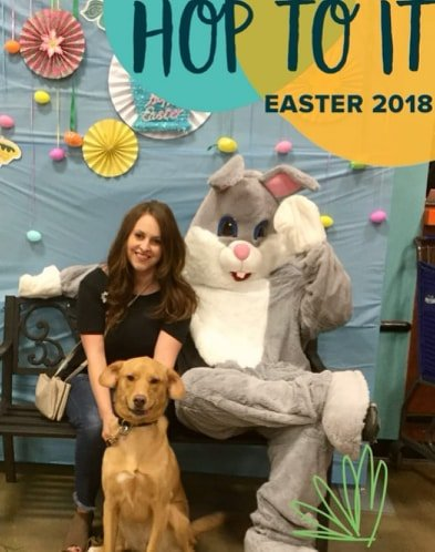 This is a photo of me with my friends dog Eve. This was taken at PetSmart this past Easter. She even smiled for the camera!