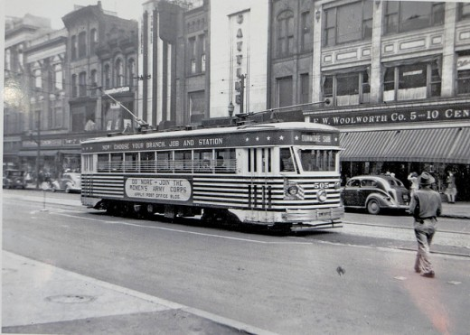 Old electric trolley in Scranton, in front of an old five and dime store.