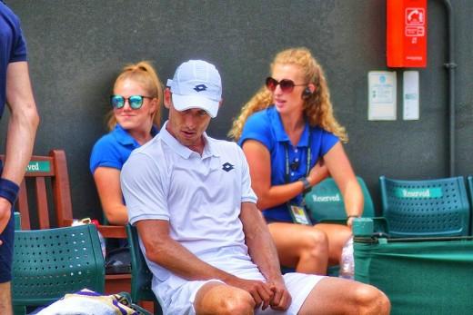 John Millman looking disconsolate as he crashes out to Milos Raonic at Wimbledon 2018.