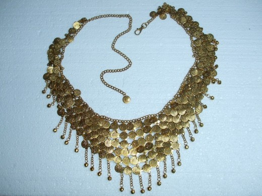 A decorative gold coin necklace. It has no hallmark and is therefore difficult to value.