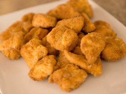 Chicken nuggets produced from whole pieces of breast meat are more desirable