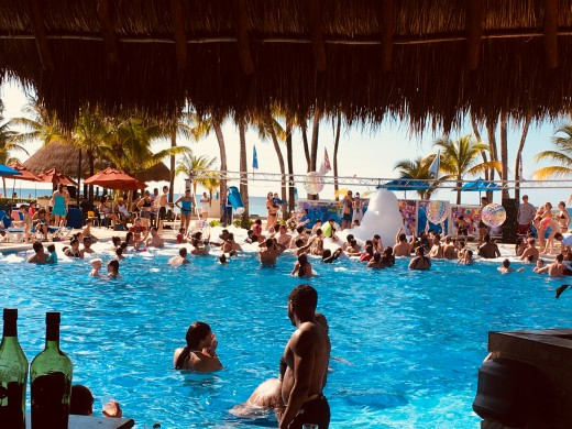 (Not usually this busy, was a foam pool party at time) Pool view from the eaterie, perfect to have a drink/snack/meal while the kids play!
