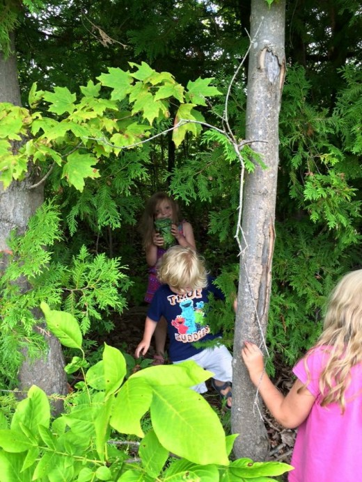 Kids working together to find a cache