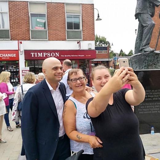 Home Secretary Sajid Javid having a selfie with members of the public.
